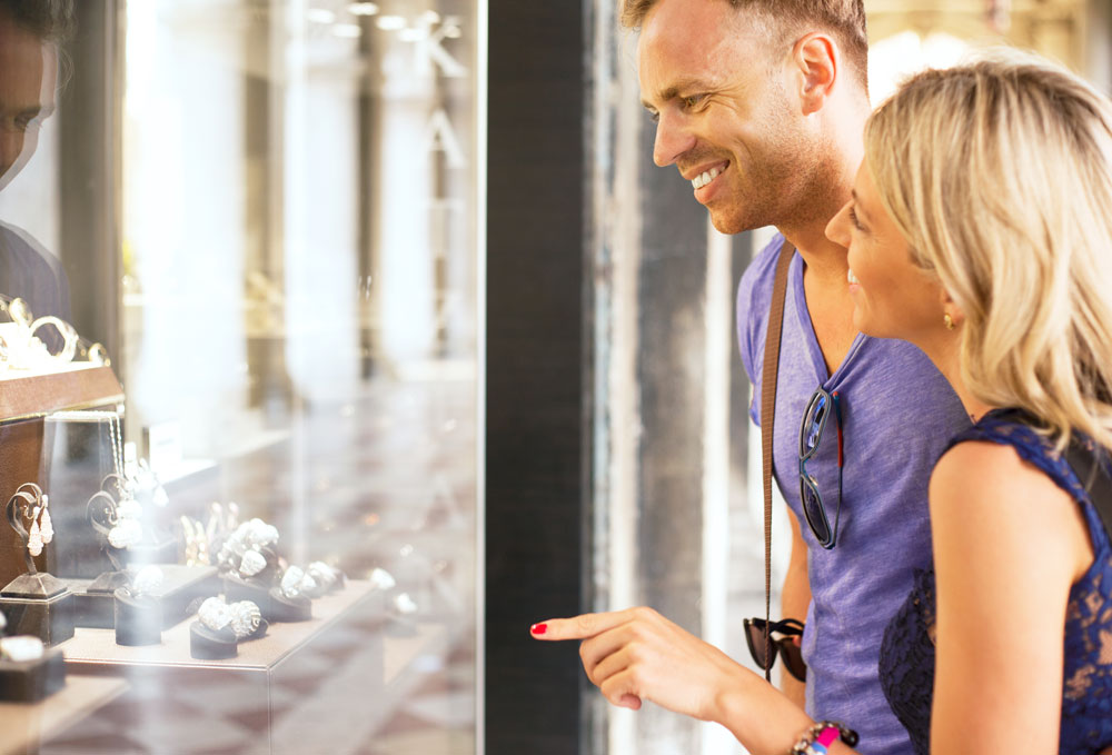 bigstock-Couple-looking-at-jewelry-stor-97755635(1000)